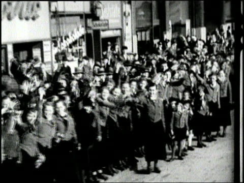 stockvideo's en b-roll-footage met armed nazi soldiers march throughout germany and stand guard over the rhine river. - 1936