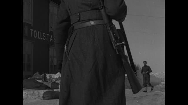 armed norwegian soldier in long overcoat walks outside tollstasjon / interior views of men eating one slicing and eating sausage / faces of officer... - telephone receiver stock videos & royalty-free footage