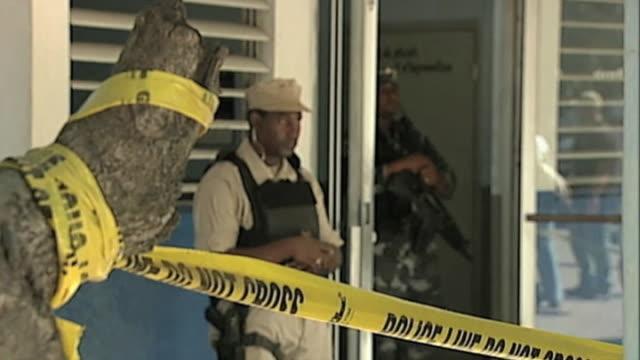 vídeos de stock e filmes b-roll de armed officers outside police headquarters following devastating earthquake haiti 3 february 2010 - hispaniola