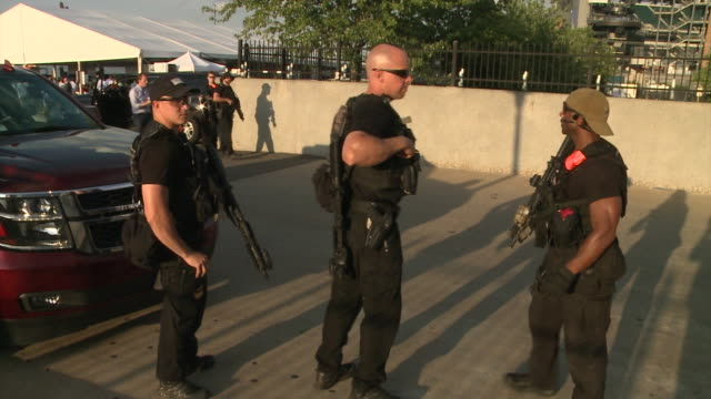 Armed police guard surroundings of the Democratic National Convention amidst protests Democratic National Convention 2016 at Wells Fargo Center on...