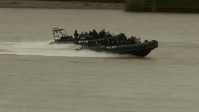 """armed police have played out the chaos of a """"pleasure boat"""" terrorist attack on the river thames in a unique marinebased exercise to test the... - vessel part stock videos & royalty-free footage"""