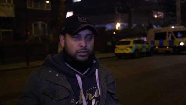 armed police have sealed off a mosque in london after a man was fatally stabbed in a nearby street includes interview with witness bahir moulana - stechen stock-videos und b-roll-filmmaterial