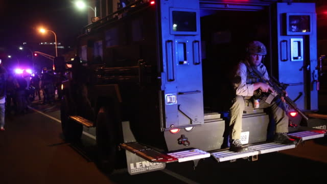 armed police officer sitting in the back of an armored vehicle during breonna taylor protest. kentucky won't pursue murder charges against the police... - armoured vehicle stock videos & royalty-free footage