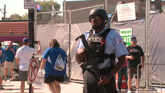 armed police officers around wrigley field before cubs playoffs game on oct. 9, 2017. - playoffs stock videos & royalty-free footage