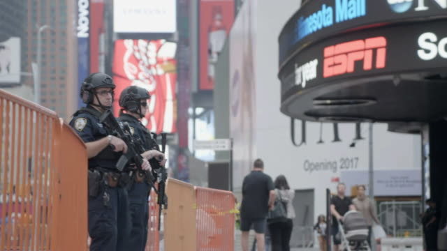 Armed police on the streets of New York City after a bomb explosion the previous evening