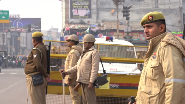 armed police on the streets of uttar pradesh after violent protests over india's controversial citizenship laws - citizenship stock videos & royalty-free footage