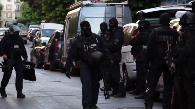 Armed police raiding apartments after the Nice terror attack
