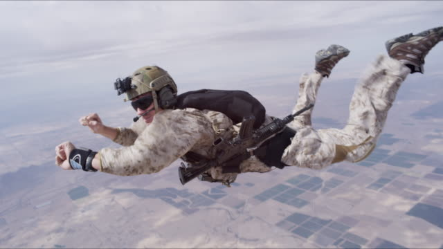 Armed Skydiver Checks Altitude Over Desert