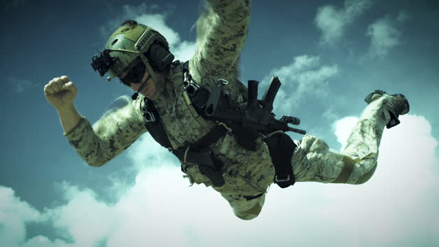 armed skydiver in free fall - ominous stock videos & royalty-free footage