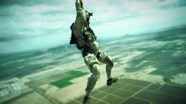 armed skydiver opens his parachute - ominous stock videos & royalty-free footage