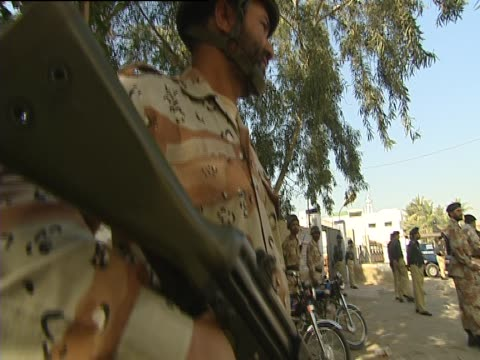 armed soldiers in karachi on election day pakistan - karachi stock videos and b-roll footage