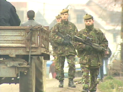 Armed soldiers patrolling streets in Kosovo
