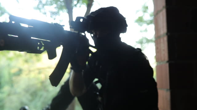 armed swat man - aiming stock videos & royalty-free footage