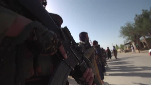 """armed taliban fighters in balkh province, afghanistan - """"bbc news"""" stock-videos und b-roll-filmmaterial"""