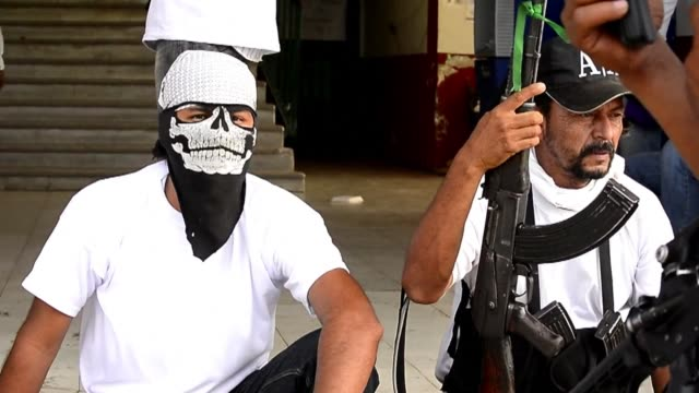 Armed vigilantes in Mexico seize another town in their fight against a drug cartel which has become the biggest security crisis of the president's...