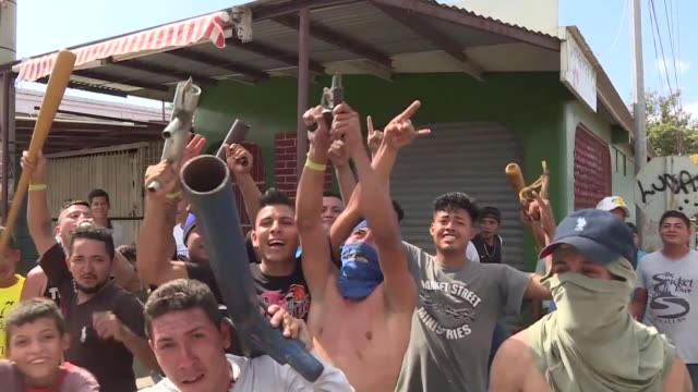 armed vigilantes roam nicaragua's capital after nicaragua's president daniel ortega scrapped a contentious pension reform that triggered four days of... - dozen stock videos & royalty-free footage