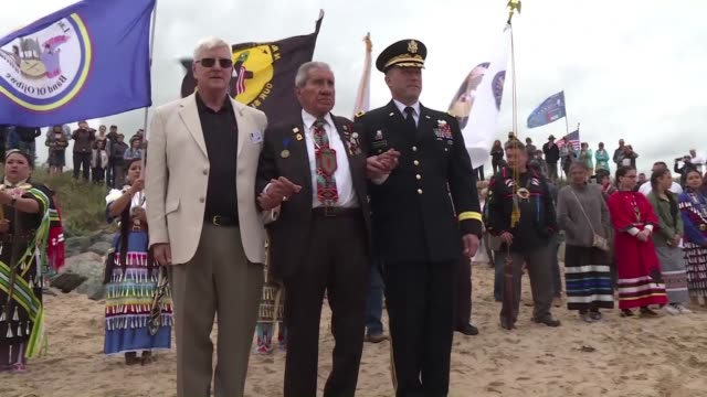 armed with feathers and incense dozens of native americans pay tribute to their forefathers on omaha beach in normandie as part of national... - omaha beach stock videos and b-roll footage