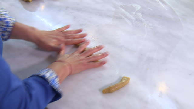 armenian cookies. top view of a woman's hands shaping the dough for zadigi kahke, armenian easter cookies. - moulding a shape stock videos & royalty-free footage