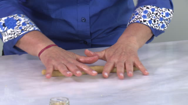 armenian cookies. view of a woman's hands rolling out the dough for zadigi kahke, armenian easter cookies. - moulding a shape stock videos & royalty-free footage