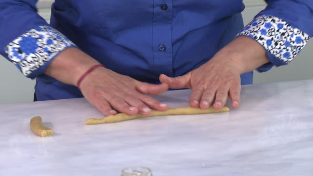 armenian cookies. view of a woman's hands shaping the dough for zadigi kahke, armenian easter cookies. - moulding a shape stock videos & royalty-free footage