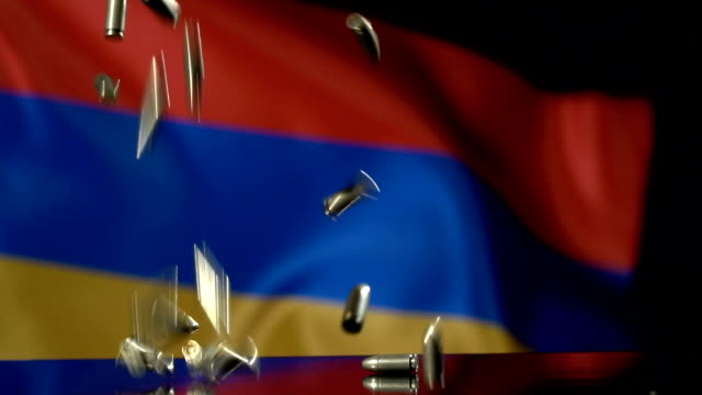 armenian flag behind bullets falling in slow motion - eastern european culture stock videos & royalty-free footage