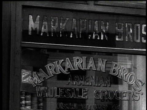 stockvideo's en b-roll-footage met 1939 ms armenian grocery storefront / new york city, new york, usa - winkelbord