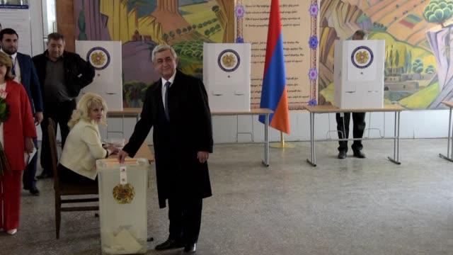 Armenian President Serzh Sargsyan votes in landmark polls as opposition parties denounce electoral violations