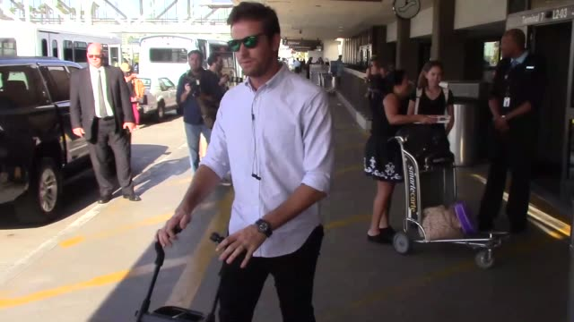 Armie Hammer Elizabeth Chambers arriving at LAX Airport with their kid in Los Angeles in Celebrity Sightings in Los Angeles