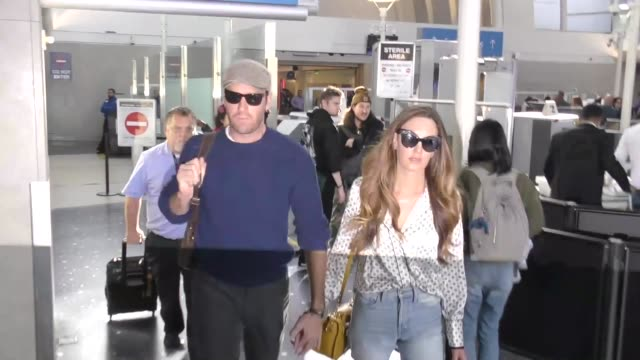 interview armie hammer elizabeth chambers talk about if he will ever use twitter while arriving at lax airport in los angeles in celebrity sightings... - armie hammer stock videos & royalty-free footage