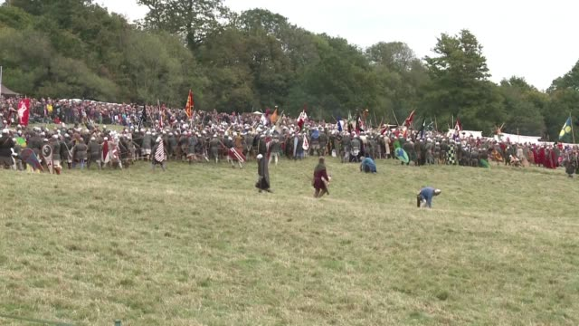 armies of enthusiasts gather to reenact the 1066 battle of hastings marking the 950th anniversary of when william the conquerors normans from france... - battle of hastings stock videos & royalty-free footage