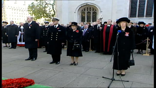 armistice day 2004; england: london: westminster abbey: ext queen elizabeth ii and prince philip, duke of edinburgh standing / bugler sounds sot... - tired stock videos & royalty-free footage