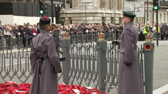 armistice day at the cenotaph; england: london: whitehall: ext soldiers approach the cenotaph / close-ups soldiers, veterans and members of the public - armistice stock videos & royalty-free footage