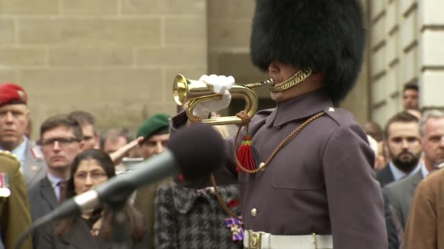armistice day at the cenotaph; soldier blows trumpet / big ben chimes - big ben stock-videos und b-roll-filmmaterial