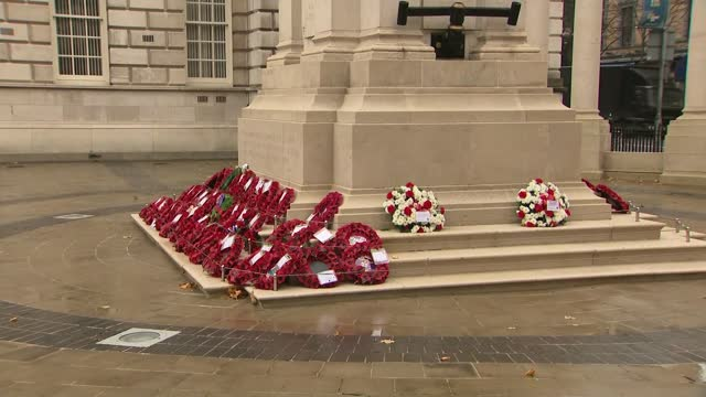 belfast ceremony; northern ireland: belfast: city hall: ext gvs poppy wreaths at memorial - armistice stock videos & royalty-free footage