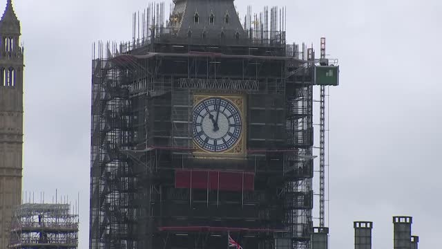 big ben at 11am; england: london: westminster: ext gvs big ben surrounded by scaffolding and bell chiming as clock strikes 11 o'clock / 11am sot - armistice stock videos & royalty-free footage