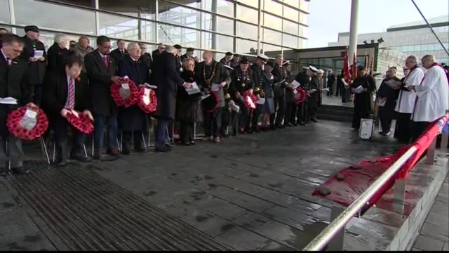 Cardiff Various of Carwyn Jones and others gathered for service to mark Armistice Day standing for two minutes silence and poppy wreaths being laid