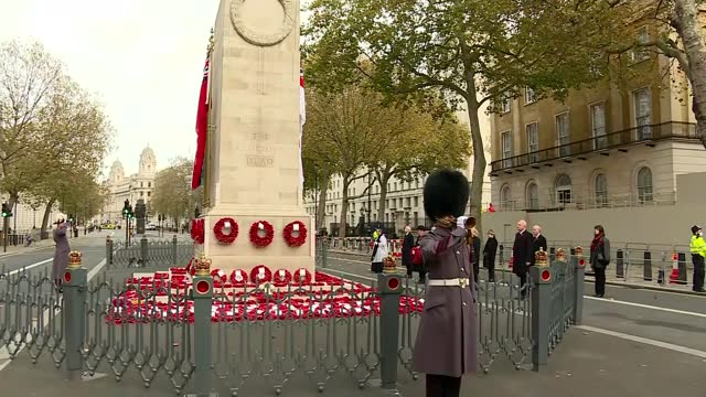 cenotaph silence; england: london: westminster: whitehall: the cenotaph: ext people observing silence around the cenotaph / big ben bells heard... - armistice stock videos & royalty-free footage