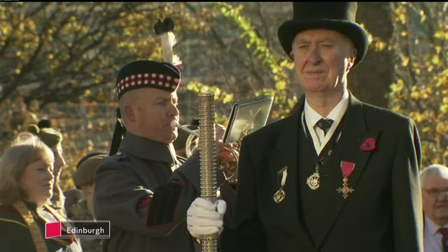 Ceremonies held around the UK to commemorate ****ASTONS SCOTLAND Edinburgh EXT Bugler playing 'The Last Post' at Armistice Day ceremony Poppy wreath...