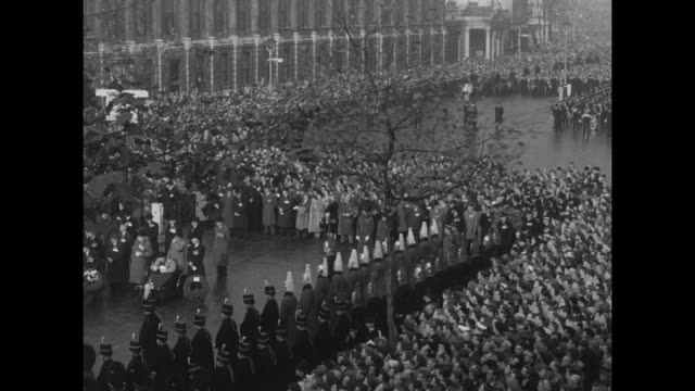 Armistice Day ceremony at Cenotaph with royal family / clergy arrives / WS medaled dignitaries standing behind wreaths as sailors stand behind /...