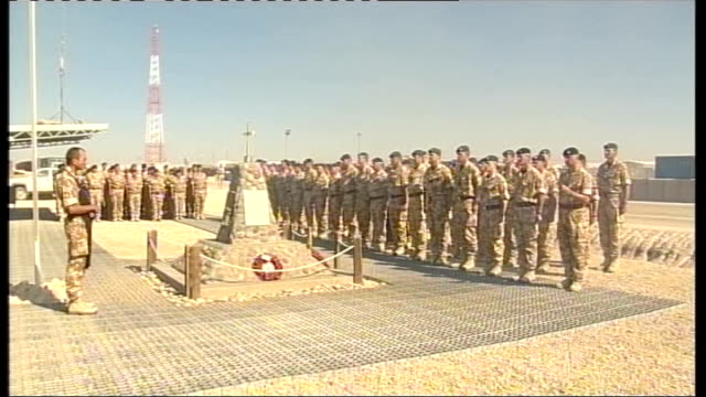 commemorations by british armed forces at camp bastion afghanistan helmand province camp bastion ext soldiers fire cannon at camp bastion to mark two... - 2001年~ アフガニスタン紛争点の映像素材/bロール