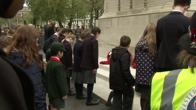 Armistice Day commemorations Cenotaph Back view children laying wreaths at the Cenotaph Wreaths at the Cenotapth