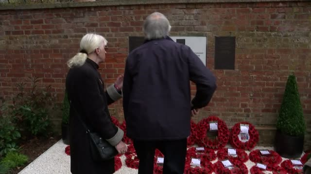 Armistice Day commemorations Close shot of message written by Jack Rigby to his father Lee Rigby Back view of Yvonne Bonnett and Raymond Bonnett...