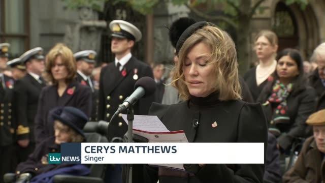 Armistice Day commemorations ENGLAND London The Cenotaph EXT Cerys Matthews reading poem 'My Boy Jack' at ceremony SOT
