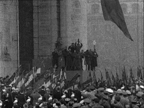 Armistice Day commemorations in Paris FRANCE Paris Arc de Triomphe and Champs Elysees EXT Rene Coty along in car / Crowds dip French flags / MS Flag...