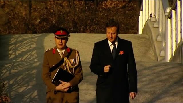 armistice day david cameron lays wreaths at korean national war memorial / cameron meets south korean president cameron and british soldier crossing... - 花輪を捧げる点の映像素材/bロール