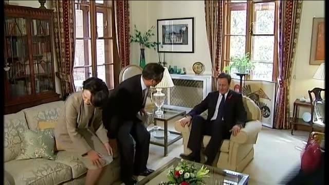 armistice day david cameron lays wreaths at korean national war memorial / cameron meets south korean president cameron shaking hands with chung... - 花輪を捧げる点の映像素材/bロール