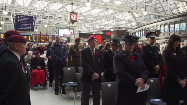 Glasgow Station SCOTLAND Glasgow Glasgow Station INT People attending service at Glasgow Station to mark Armistice Day singing hymn observing the two...