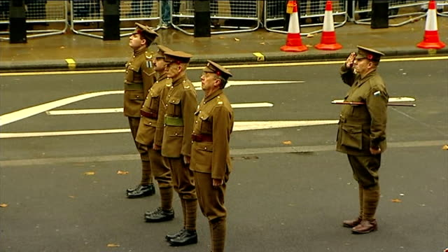 armistice day marked across the country men dressed in world war 1 uniforms standing before the cenotaph as the last post is played pull the glorious... - リチャード・パロット点の映像素材/bロール