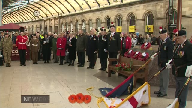 Armistice Day marked NewcastuponTyne INT Veterans and others stand for Armistice Day minute silence in Newcastle Station