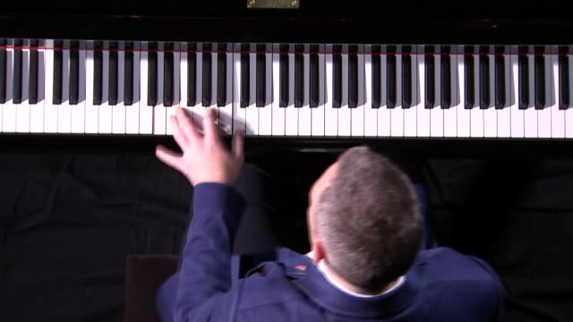 Armistice Day Onehanded pianist performs concerto written for veteran ENGLAND London **McCarthy interview partly overlaid SOT** High angle view of...